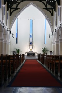 The liturgical heirarchy from sacristy to altar to nave is reinforced by the lighting scheme.