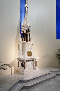 Spotlighting on the marble sacristy spire highlights the tabernacle within.