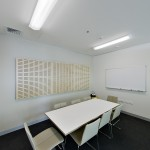 Meeting rooms and private offices are located in designated 'built zones' along the centre of the floor plate.