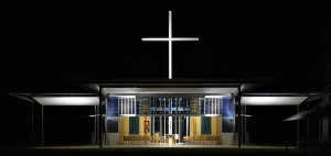 A great cross, in industrial galvanised steel, rises above the chapel to 15m height.  The cross is lit by four Bega '7500 Series' very narrow beam floodlights (hidden at the low point of the roof) with linear spreader lenses – two oriented vertically and two horizontally.