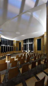 For mass, uplighting is reduced, font lighting is removed, and spotlighting of the lectern and ambo added.  The ceiling is up-lit from behind, through coloured glass louvres.  This serves to 'hush' the space and focus attention onto the liturgy.