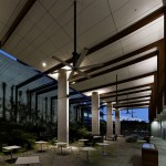 The open air foyer with HVLS fans avoids the need for excess conditioned space.