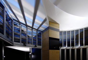 Floodlighting through stained glass louvres provides a lighting effect on the ceiling.  Bega '7500 Series' fittings are discreetly mounted externally, provided with spreader lenses and hoods, and carefully aimed to prevent glare inside.